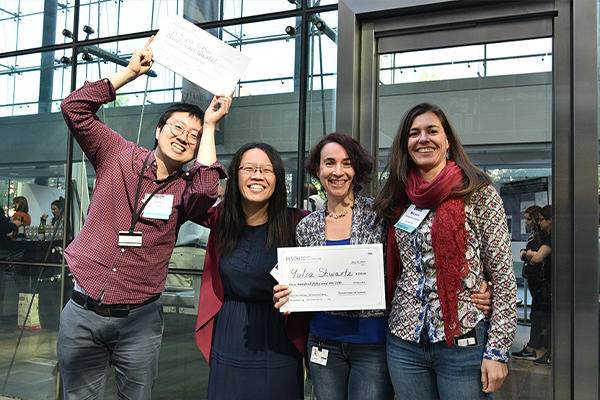 Ya-Chieh Hsu with award-winning members of her lab at the HSCI 2019 annual retreat